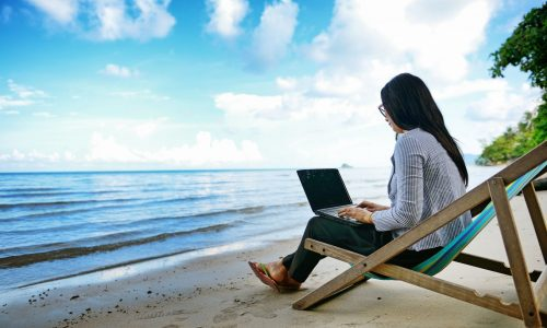 woman-laptop-beach